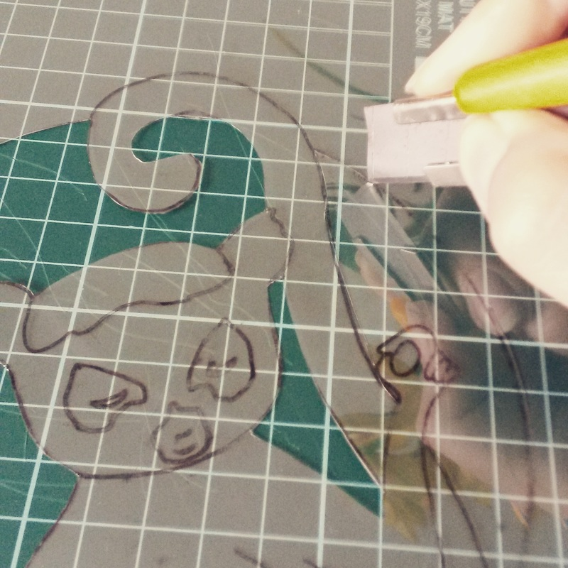 Cutting out the lemur stencil from thin acetate